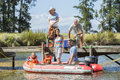 Multi-Generation Family Enjoying Boat Trip On Lake Royalty Free Stock Photo