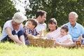 Multi Generation Family Enjoying Picnic In Countryside Royalty Free Stock Photo