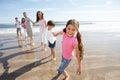 Multi Generation Family Having Fun On Beach Holiday Royalty Free Stock Photo