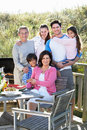 Multi generation family having outdoor barbeque smiling to camera Royalty Free Stock Photography