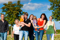 Multi-generation family on meadow in summer Stock Photo