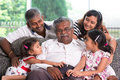 Multi generations indian family portrait of at home asian people living lifestyle Stock Photos