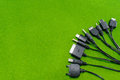 Multi heads of mobile phone charger universal charger on green background Royalty Free Stock Photos