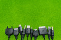Multi heads of mobile phone charger universal charger on green background Royalty Free Stock Image