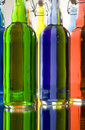 Multi hued bottles many different colored photo Stock Images
