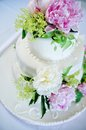 Multi level white wedding cake with pink roses Stock Photography