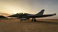 Multi role fighter jet aircraft on runway at sunset Stock Image