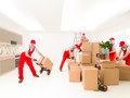 Multi tasking delivery man at work delivering cargo to new house digital composite image Stock Photos