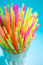 Multicolor flexible straws in the glass closeup Royalty Free Stock Photo