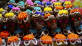 Multicolor hair chocolate skulls mexican typical made of sugar in the day of the dead mexican celebration day with sugar pasta as Stock Image