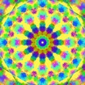 Multicolor paint splashes forming a mandala circle on a yellow background