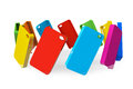 Multicolor plastic mobile phone cases on a white background Royalty Free Stock Photo
