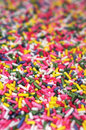 Multicolor sugar sprinkles for cake decoration vertical shot Royalty Free Stock Photos