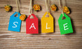 Multicolor tags lettering sale on wood Stock Images