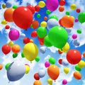 Multicolored balloon s released into the sky Stock Photo