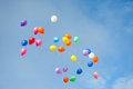 Multicolored balloons in the blue sky Stock Images