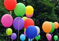 Multicolored balloons in the city festival Royalty Free Stock Photo