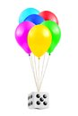 Multicolored balloons and dice isolated on white background Royalty Free Stock Photo