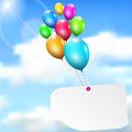 Multicolored balloons with paper card on sky background sun and clouds Stock Photography