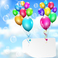 Multicolored balloons with paper card on sky background sun clouds and soap bubbles Stock Images