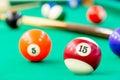 Multicolored balls on green baize of billiard Royalty Free Stock Photos