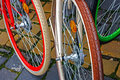 Multicolored bicycle wheels detail with to a group of bicycles Stock Photography