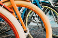 Multicolored bicycle wheels in a row, close-up. Royalty Free Stock Photo