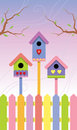 Multicolored birdhouses on spring background Stock Photography