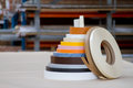 Multicolored bobbins of PVC edge and melanin for the manufacture of furniture. Lie pyramid. Royalty Free Stock Photo