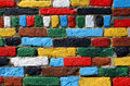 Multicolored brick wall of red yellow white black green and blue bricks Royalty Free Stock Photo