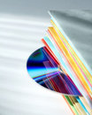 Multicolored brochures and disk Royalty Free Stock Photo