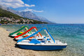 Multicolored catamaran on beach at croatia vacations background Stock Images