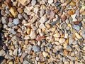 Multicolored colorful sea pebbles, natural background, texture. Close-up texture of colorful sea pebbles. Small Rock Royalty Free Stock Photo