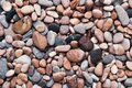 Multicolored colorful sea pebbles, natural background, texture. Close-up texture of colorful sea pebbles. Small Rock. Sea backgrou Royalty Free Stock Photo