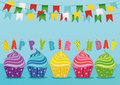 Multicolored cupcakes with letters and words on the birthday candles