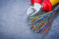 Multicolored electric cables nippers on black background electri Royalty Free Stock Photo