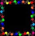 Multicolored handprints border isolated on black background