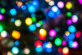 Multicolored holiday lights abstract background of defocused Royalty Free Stock Image
