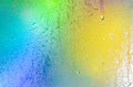 Multicolored lights abstract background on steamy window Royalty Free Stock Image