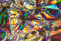 Multicolored metallic background detail close up of strongly wrinkled paper as a colorful structured image in rainbow colors with Royalty Free Stock Photos