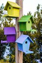 Multicolored nesting boxes closeup outdoor background