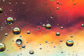 Multicolored oil and water abstract giving the impression of planets Royalty Free Stock Images