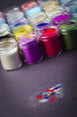 Multicolored paint in jars for makeup artistry a lot of Royalty Free Stock Photography