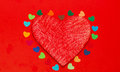 Multicolored paper hearths around a wooden red heart Royalty Free Stock Photography