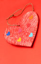 Multicolored paper hearths on a wooden red heart Royalty Free Stock Image