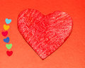 Multicolored paper hearths with a wooden red heart Royalty Free Stock Photography