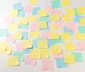 Multicolored paper stickers on wall photo of empty front view Stock Photo