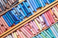 Multicolored pastel crayons in wooden artist box closeup Royalty Free Stock Photo