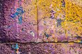 Multicolored purple orange graffiti close-up on rough concrete block wall texture Royalty Free Stock Photo