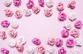 Multicolored roses lined frame on pink background top view close up place text frame a for Royalty Free Stock Images